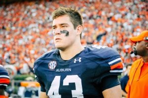 Auburn Football game philip lutzenkirchen in front of crowd